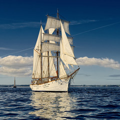 Sailing ship in the blue sea.  Yachting. Sailing