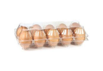 Chicken eggs in a plastic container