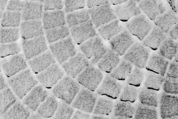 Steinmuster im Schnee