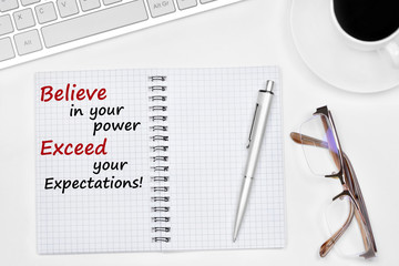Believe in your power Exceed your expectations text on notebook