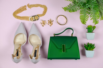 Fashion woman accessories set. Trendy Collection of white, gold and green, shoes heels, handbag clutch, necklace on pink background