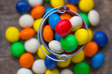 Colorful candy in a small metal bucket