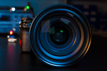 Photo Camera or Video lens close-up on black background DSLR objective