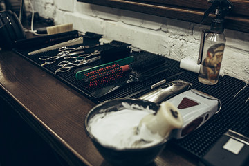 Barber shop tools on the table. Close up view shaving foam.