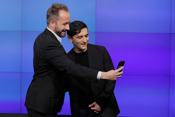 Dropbox Inc. co-founders Houston and Ferdowsi pose for a photograph as Dropbox (DBX) is listed for the company's IPO in New York
