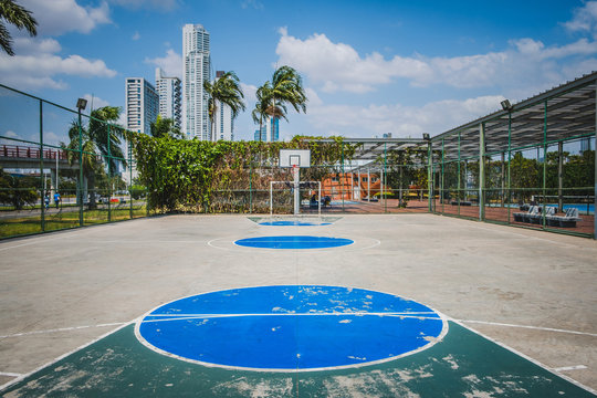 sports field, basketball court with city background