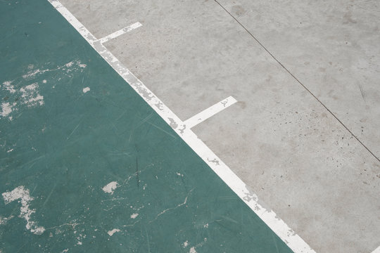lines on sport field - old outdoor basketball court floor detail