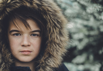 Portrait of teenage girl wearing fur hood