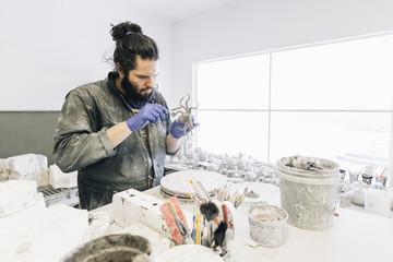 Craftsman working in workshop