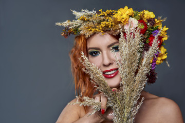 red-haired girl with flowers in her hair