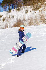 Full-length picture of athlete in helmet with snowboard