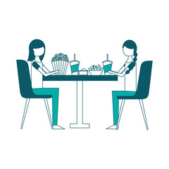 young women sitting on chairs with round table pop corn soda nachos vector illustration green design