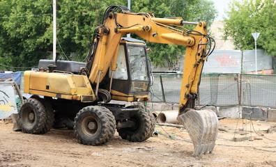 wheeled excavator on ground