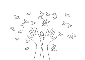 Hands releasing a flock of birds.