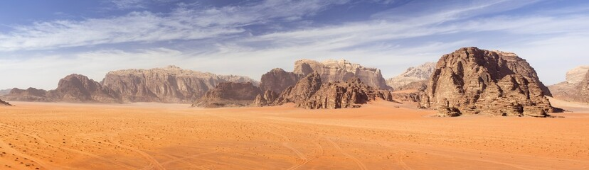 Acrylic Prints Desert panoramic view to red sand desert with mountains rocks in Jordan