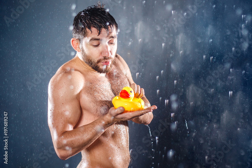 Naked men with a rubber ducky photo 149
