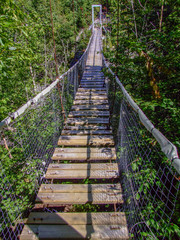 Wood and rope bridge suspended over White River Gorge