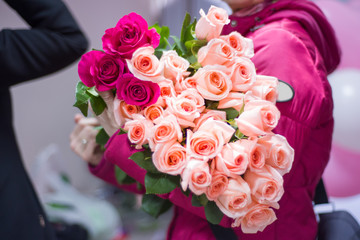 A bouquet of roses on hand at the hospital.