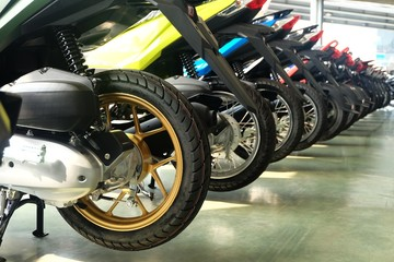 Many colorful motorcycles behind at the Showroom for sale