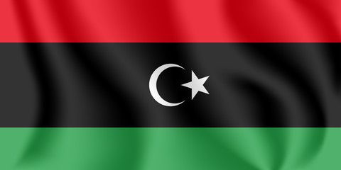 Flag of Libya. Realistic waving flag of State of Libya. Fabric textured flowing flag of Libya.