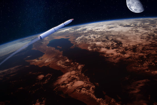 Hypersonic missile or rocket over the apocalyptic Earth. Blue Moon in the sky. Elements of this image furnished by NASA