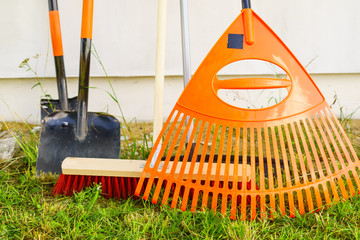 Gardening tools, rake, shovel and broom