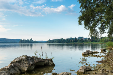 Lake in northern Italy. Varese Lake with Virginia islet, Biandronno. The island (in the center - left) is a site of prehistoric finds, added to the UNESCO World Heritage Site. Summer landscape