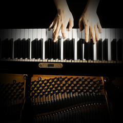 Acrylic Prints Music Piano keyboard hands. Playing piano keys closeup