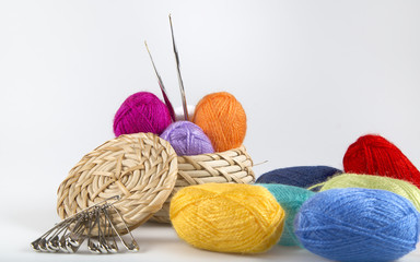 colored wool yarn in basket