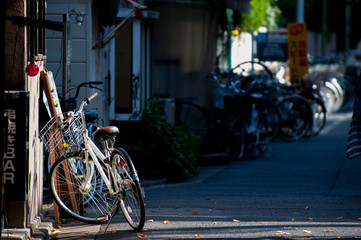 Bicycles in Tokyo, Japan. Tokyo has many bicycles since the land is pretty flat. Many Japanese people ride bicycles as a transport.
