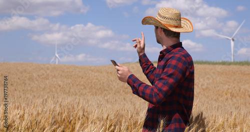 Farmer Man Using Digital Tablet Modern Technology Looking Out in Golden Wheat Field Plantation