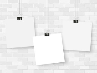 Posters on binder clips mockup brick wall notes square