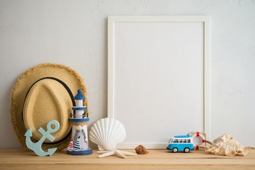 White vintage photo frame on old wooden table over white wall background with beach accessories - Summer tropical beach holiday traveling concept