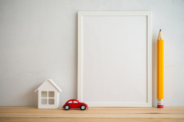 Photo frame and house car property, pencil education on white wall background, creative ideas family concept