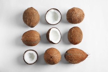 Ripe coconuts on white background, flat lay