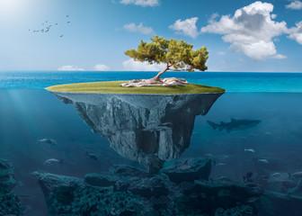 Idyllic small island with lone tree deep in the ocean