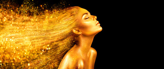 Fashion model woman in golden bright sparkles. Girl with golden skin and hair portrait closeup. Holiday glamour shiny professional makeup on black