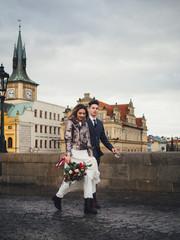 Groom and bride in charles bridge. winter wedding in Prague
