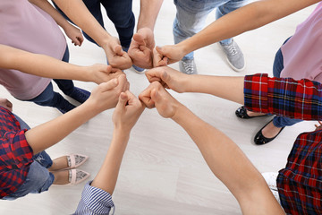 Group of people standing in circle and showing thumb-up gesture. Unity concept