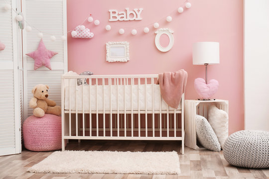 Beautiful interior of baby room with  crib