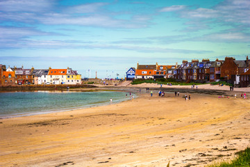 North Berwick beach and tourists walking on the sand, East Lothian