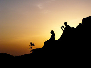 Silhouette of couple at sunset, Khandala, India
