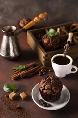 Chocolate muffins with a cup of coffee on the table
