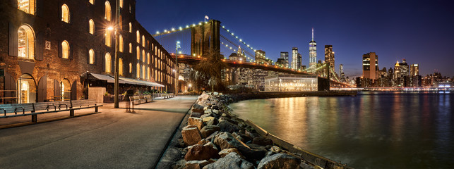 Brooklyn Bridge Park waterfront in evening with view of skyscrapers of Lower Manhattan and the Brooklyn Bridge. Brooklyn, Manhattan, New York City Wall mural