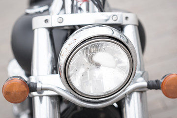 front light on the vintage MILITARY MOTOR BIKE. a lot of chrome