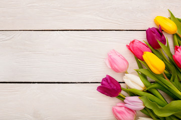 Spring decorations objects isolated on wooden background tulips in the corner
