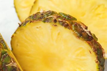 Fresh sliced pineapple on a cutting board