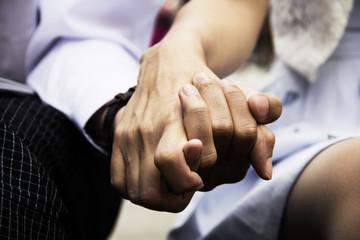 Beautiful holding hand close up.