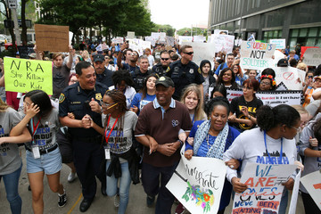 "Houston Police Chief Art Acevedo, Houston Mayor Sylvester Turner, U.S. Rep. Sheila Jackson Lee and student organizers lead the ""March for Our Lives"", an organized demonstration to end gun violence, in downtown Houston"