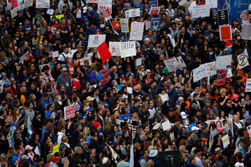 "People gather during the ""March for Our Lives"", an organized demonstration to end gun violence, in downtown Los Angeles, California"